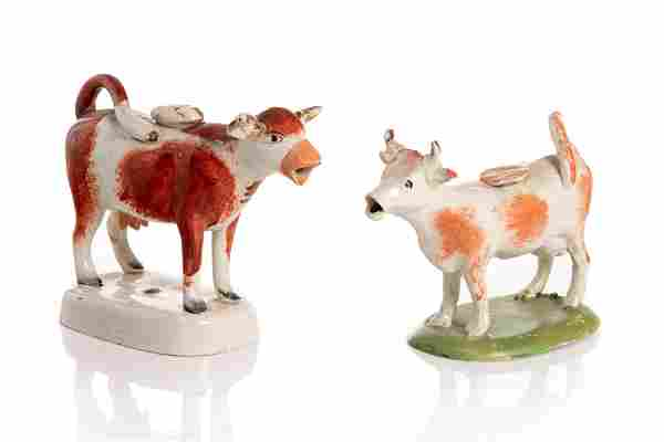 TWO 19TH C STAFFORDSHIRE COW CREAMERS