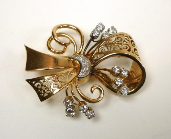 1021: YELLOW AND WHITE GOLD & DIAMOND BOW BROOCH