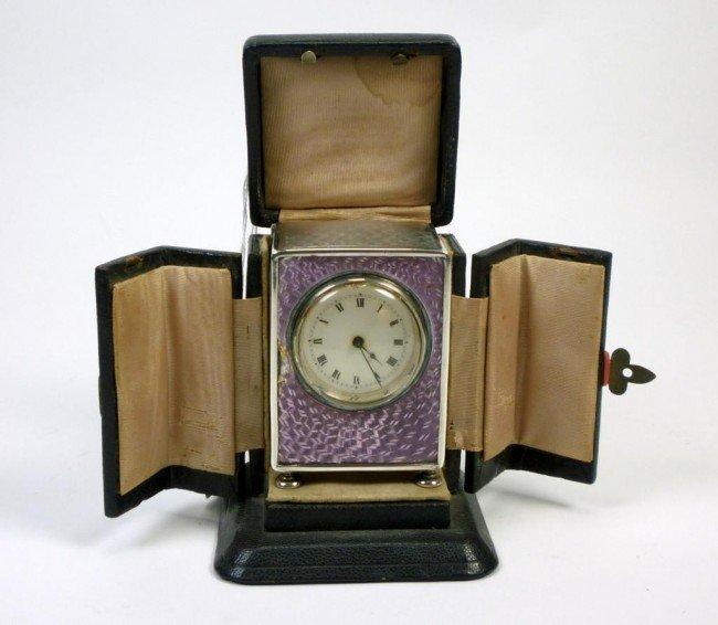 1049: ENGLISH SILVER AND ENAMEL CLOCK LIBERTY & CO