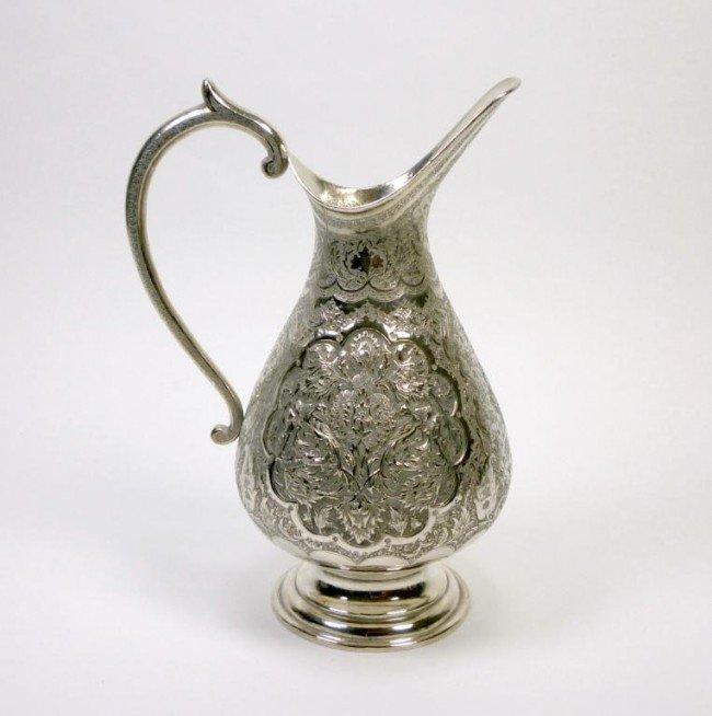 1068: PERSIAN SILVER JUG