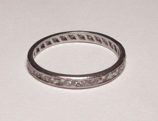 1004A: WHITE & GOLD DIAMOND ETERNITY BAND