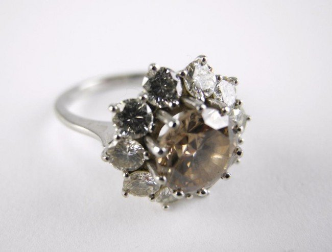1008: WHITE GOLD AND DIAMOND CLUSTER RING