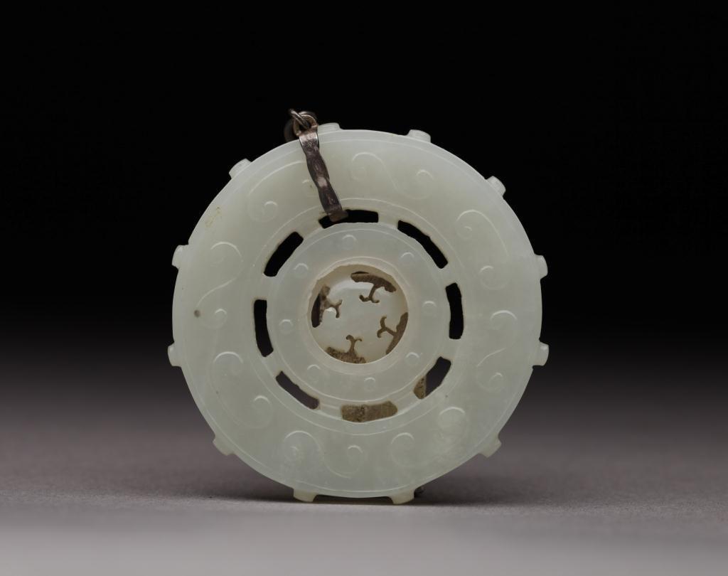 1120: CHINESE CARVED WHITE JADE BI-DISC PRAYER WHEEL