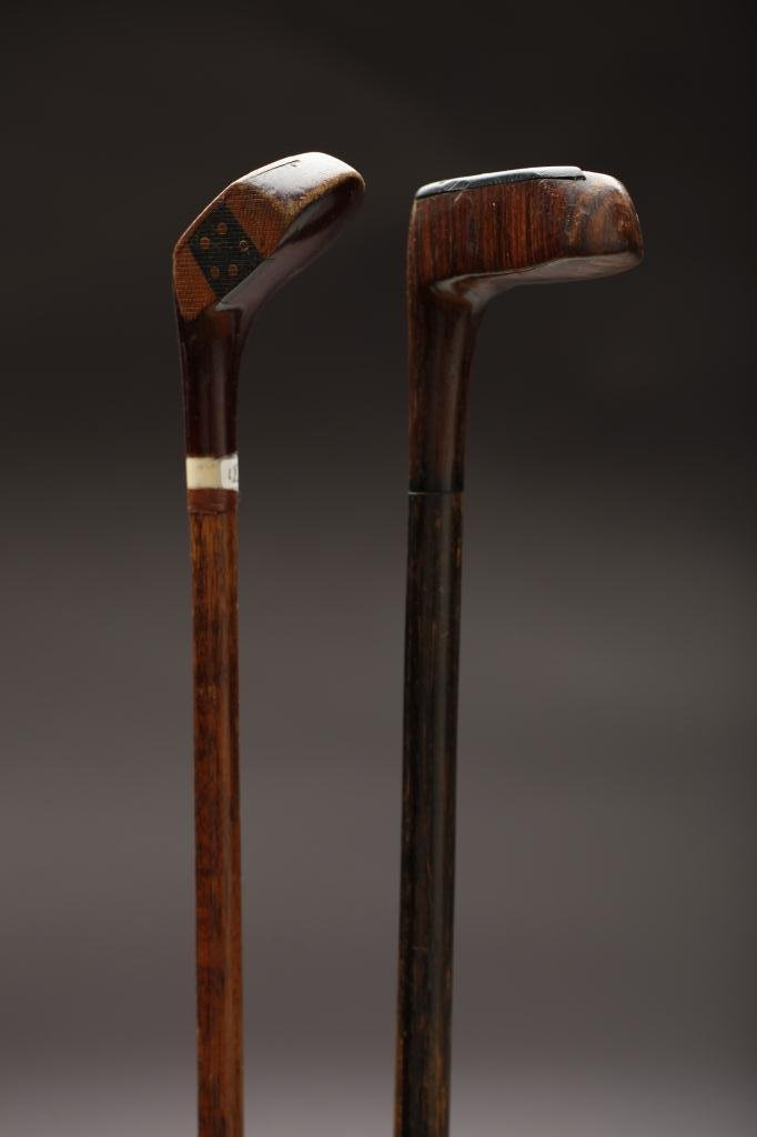 2024: TWO WOODEN GOLF CLUB-SHAPED WALKING STICKS