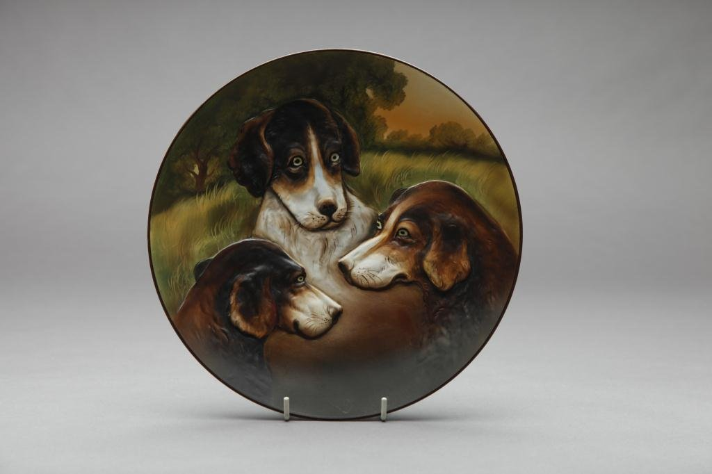 2049: EARLY NORITAKE MOULDED THREE DOG PLAQUE