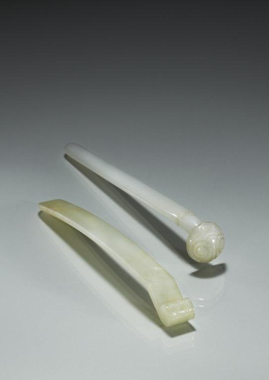 1019: TWO CHINESE CARVED JADE HAIR PINS