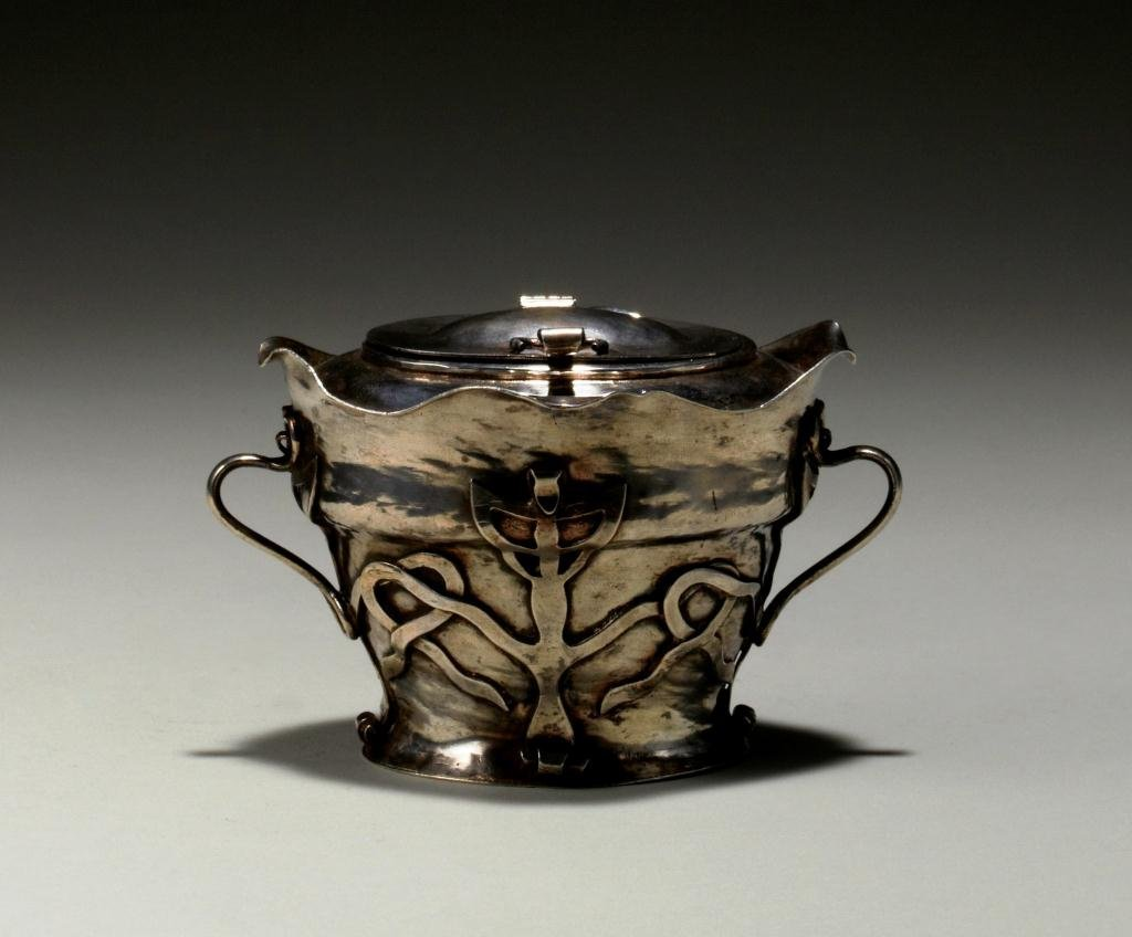 2002: ENGLISH ARTS AND CRAFTS SILVER TEA CADDY