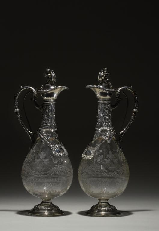 2025: PAIR OF CONTINENTAL SILVER & GLASS CLARET JUGS