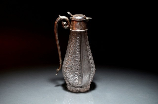 11: VICTORIAN CUT GLASS AND SILVER EWER