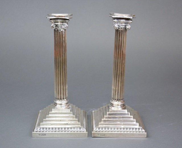 Pair of large Edwardian silver candlesticks