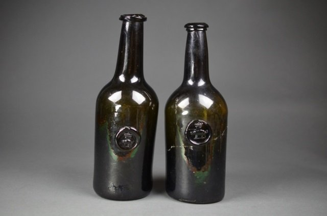 Two 18th Century glass wine bottles