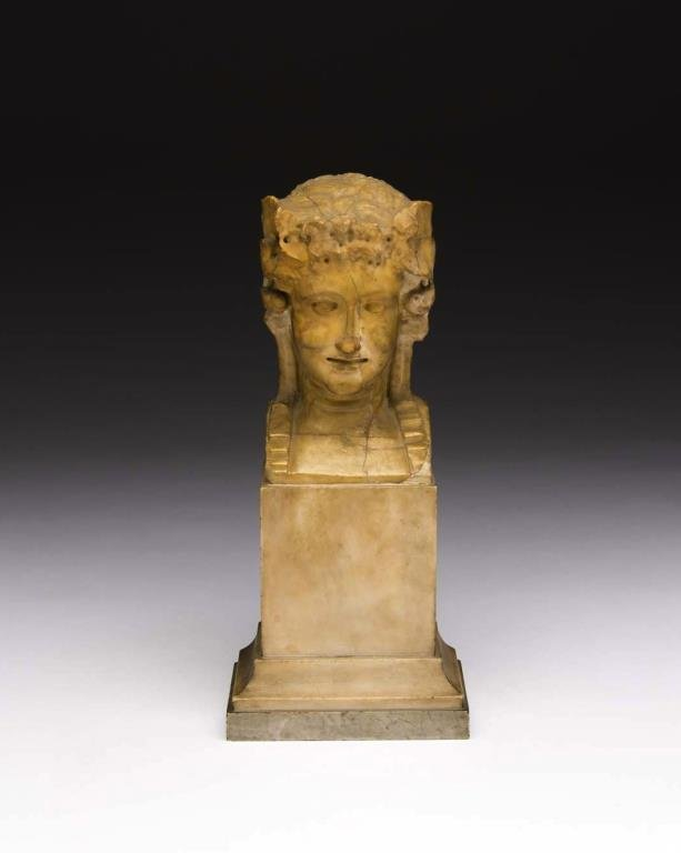AN EARLY CARVED MABLE BUST OF HERA