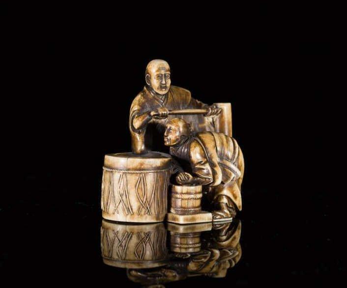 JAPANESE IVORY OKIMONO OF MOCHI MAKING