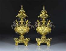 PAIR OF FRENCH PATINATED AND GILT BRONZE URNS