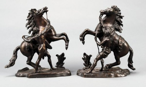 8: A pair of small bronze Marley horses