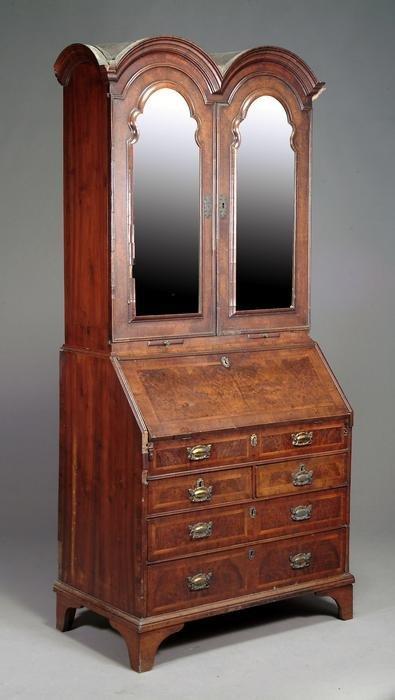115: A George II walnut bureau bookcase
