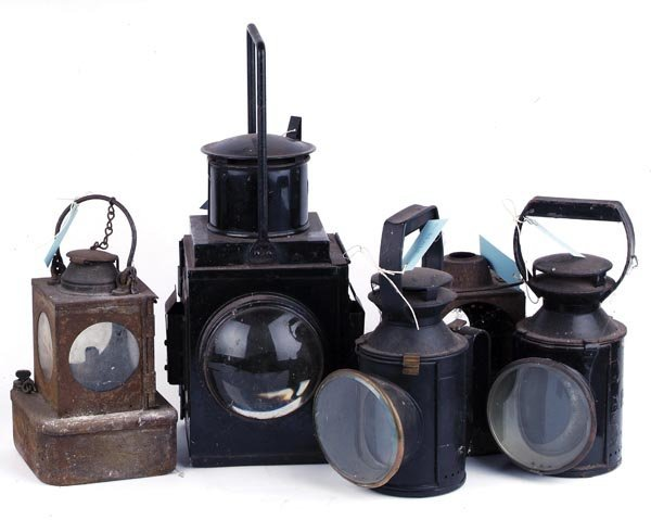 10: A collection of five railway lamps