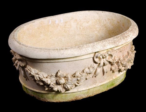4: A reconstituted stone oval jardiniere or plan