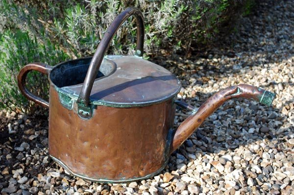 17: A Victorian copper watering can, mid 19thcent