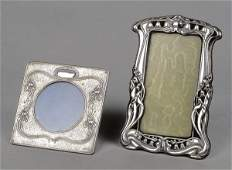 115 An Art Nouveau silver mounted shaped rectangularea