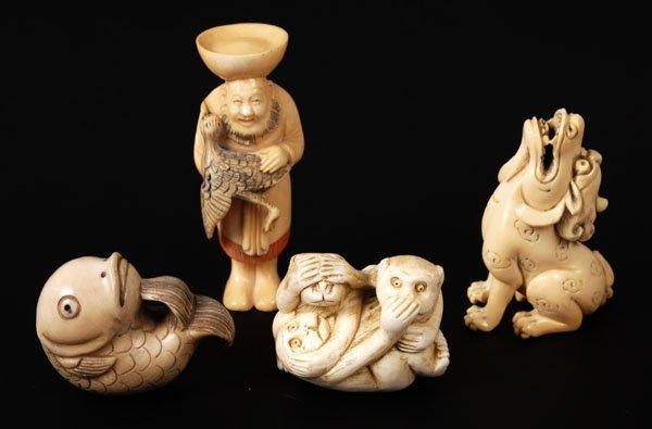701: Two Japanese ivory netsuke, comprising a seatedBud
