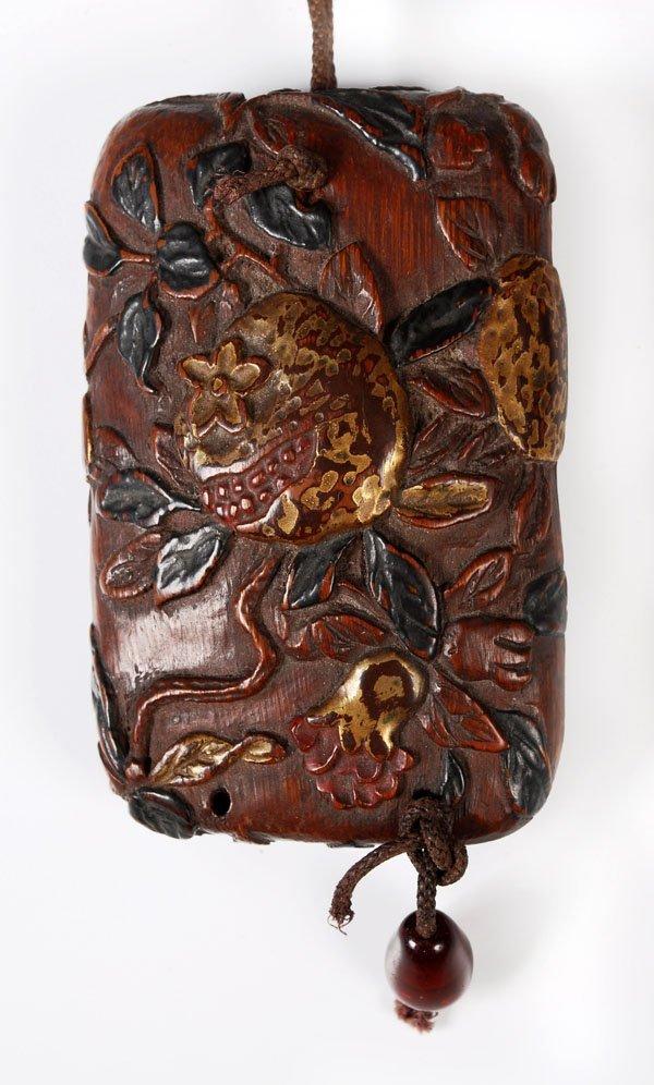 702: An unusual Japanese carved wood portableinkstone,