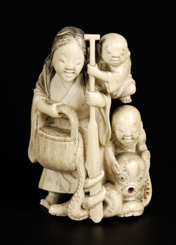 703: A Japanese ivory okimono, probably Meiji period,ca