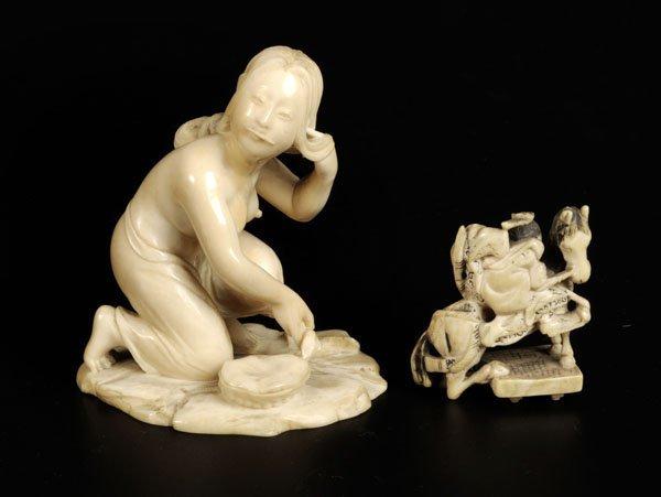 705: A Japanese ivory figure of a semi-nude washerwoman