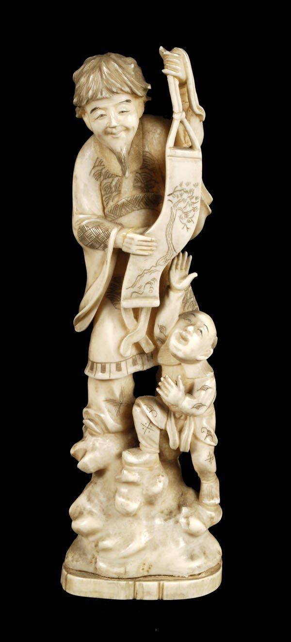 707: A Japanese walrus ivory okimono of a sage with asc