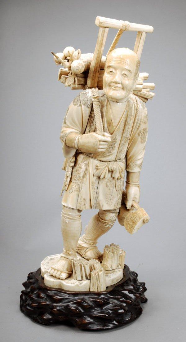 710: A large Japanese walrus ivory okimono of awoodsman
