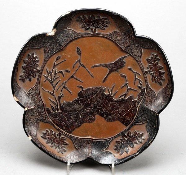 715: A Japanese brown lacquer dish, of cinquefoilshape