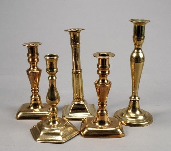 211: A George I brass candlestick, circa 1720, the sock
