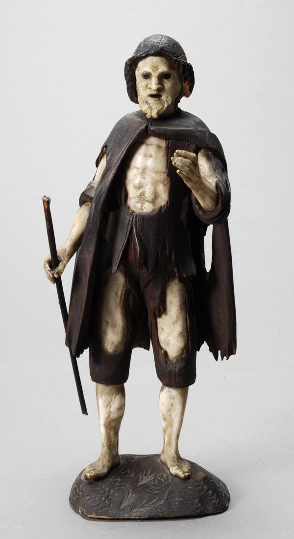 339: A Continental carved ivory and fruitwood figure of