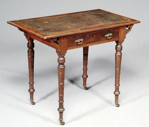 525: A Victorian walnut writing table, circa 1880, the