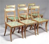 686: A set of six green painted dining chairs, in Georg
