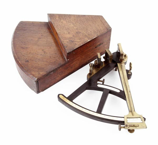 10: An ebony and lacquered brass navigational octant,
