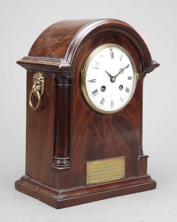 6: An Edwardian mahogany mantel clock, the French eig