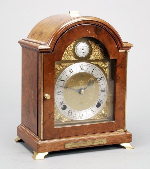 7: A small walnut bracket mantel clock, 20th century