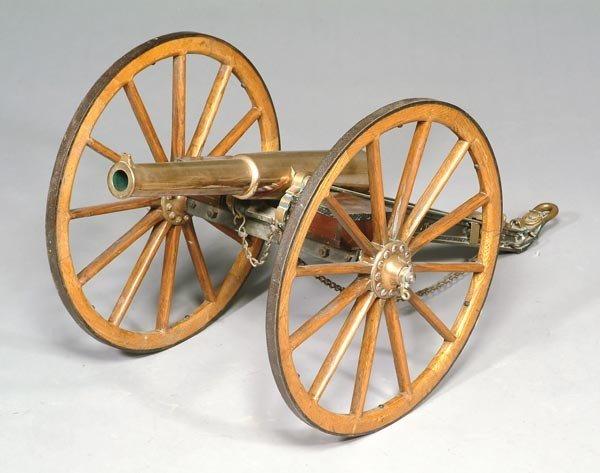 14: A bronze signal canon, 19th century, the 68cm long