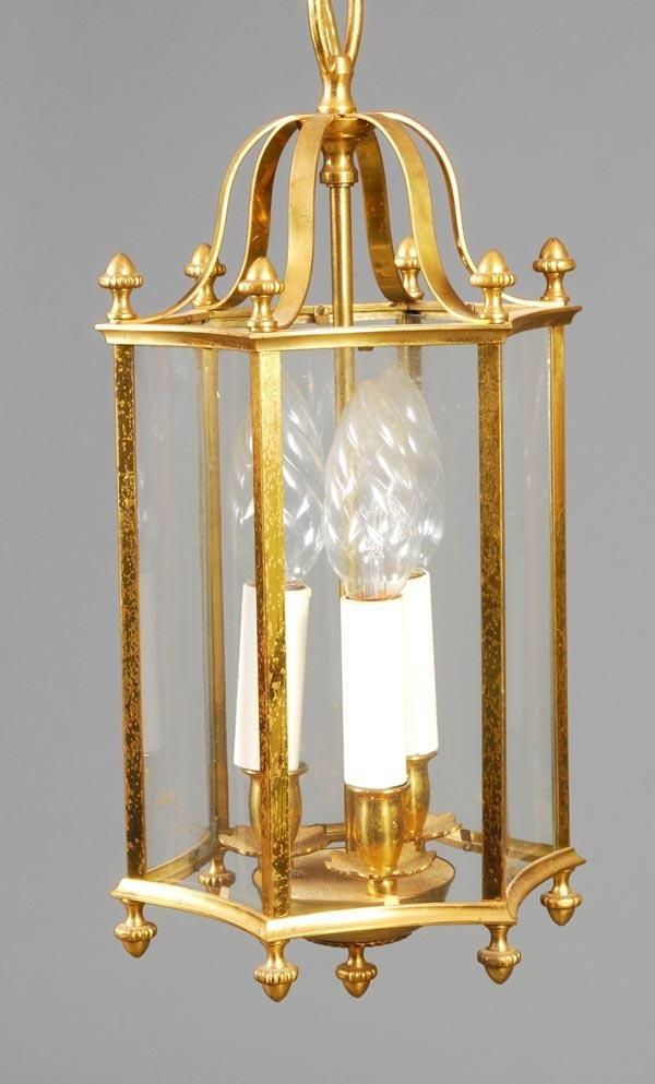 20: A gilt metal and glazed hall lantern, second half