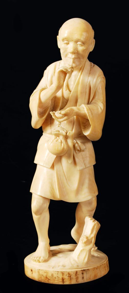 4: A Japanese ivory carving, Tokyo school, signed Yuk