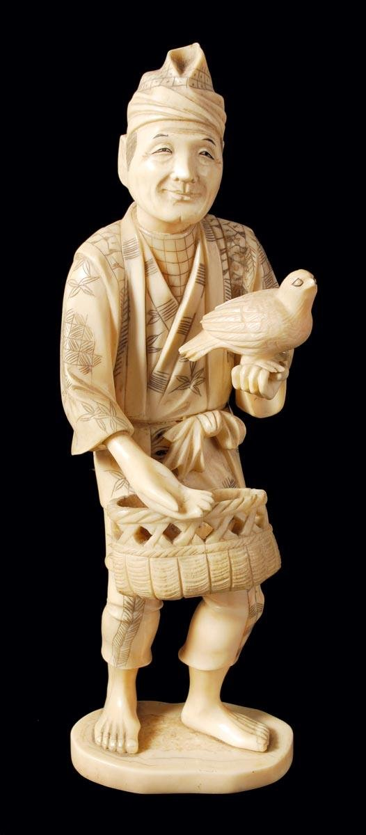 8: A Japanese ivory carving of a standing smiling man
