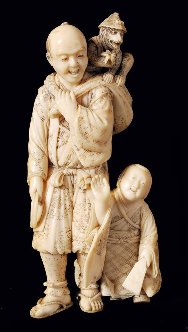 9: A finely carved Japanese ivory okimono of a standi