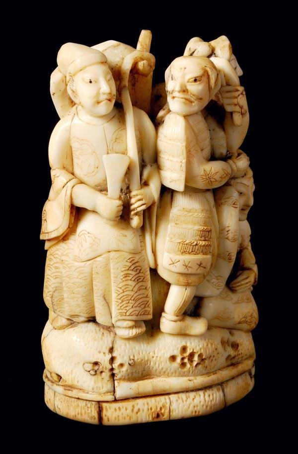 12: A Japanese walrus ivory group of figures, late 19t