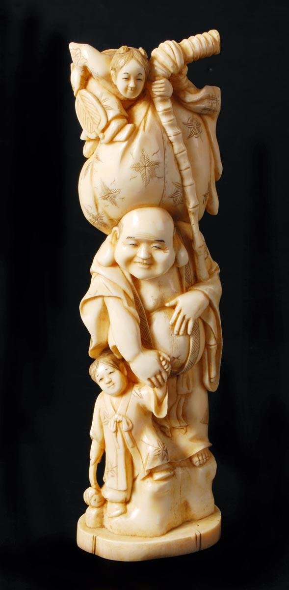 14: Japanese walrus ivory figure of Hotei, signed Koic