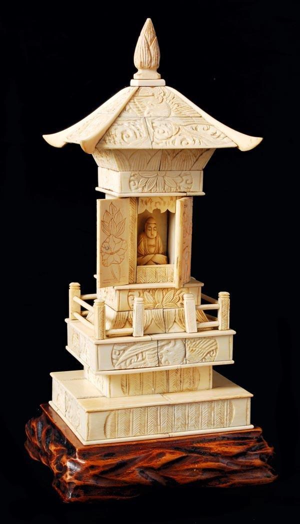 15: A Japanese sectional ivory model of a wayside shri