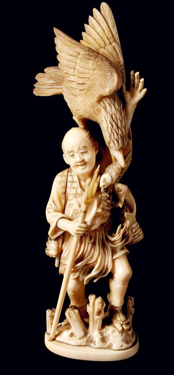 16: A Japanese sectional ivory figure of a fisherman,
