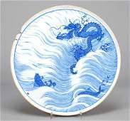 163: A Chinese underglaze blue plaque, Kangxi mark but