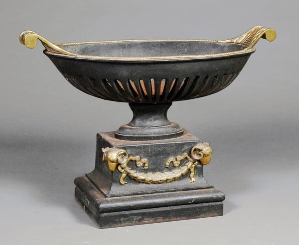 2: A cast iron and metal mounted brazier or fire bask