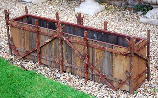 4: A pair of timber and wrought iron framed planters
